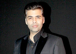 Karan Johar lashes out at twitter user over snide comment