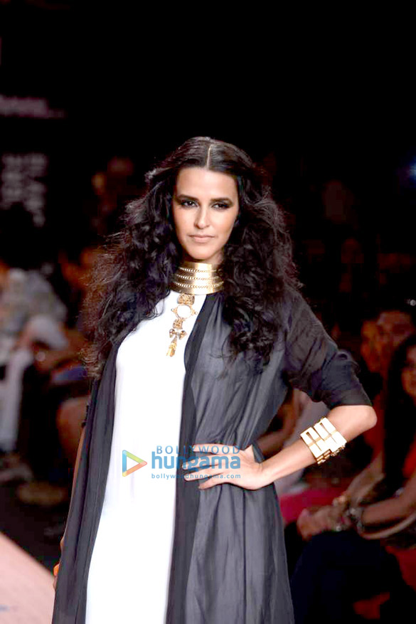 Neha Dhupia walks the ramp for 'Save Our Tigers' at Lakme Fashion Week 2013