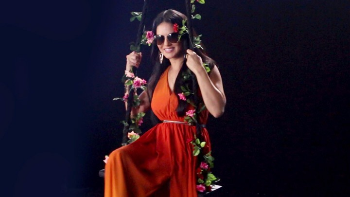 Check out Sunny Leone poses on a swing for a sexy photoshoot1
