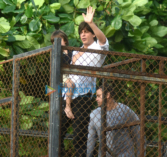 Shah Rukh Khan and Abram snapped waving and wishing fans Eid Mubarak at Mannat