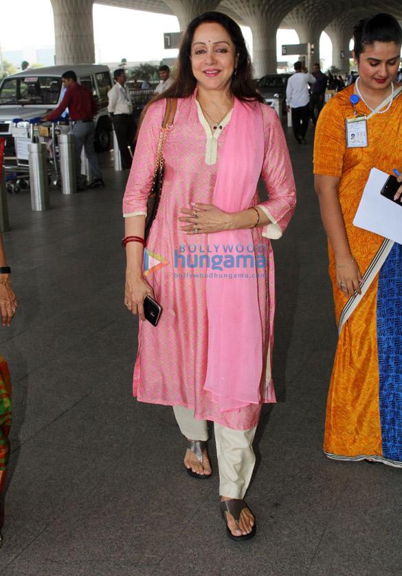 Hema Malini and Angad Bedi snapped at the airport
