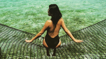 Shenaz Treasury poses sexily on a fishing net in Maldives
