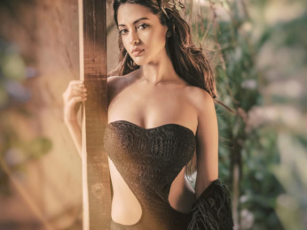 Riya Sen sizzles in this black swimsuit and she looks as sexy as ever