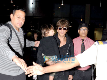 Shah Rukh Khan & AbRam snapped arriving from London