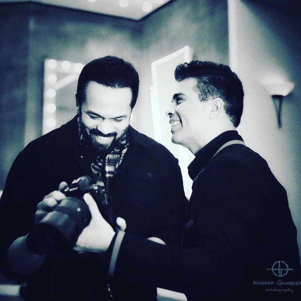 Karan-Johar-spotted-in-a-candid,-happy-moment-with-Rohit-Shetty-features