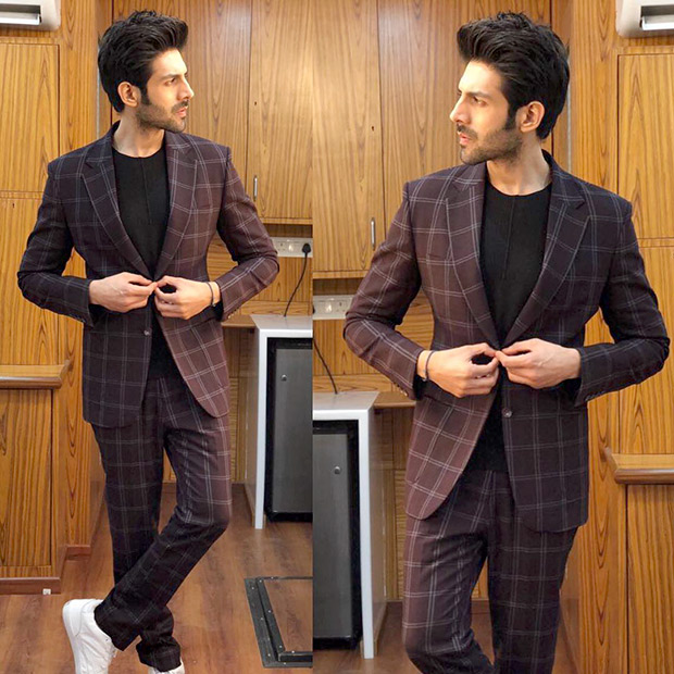 Kartik Aaryan makes a dapper style statement with a checkered suit for Sonu Ke Titu Ki Sweety promotions