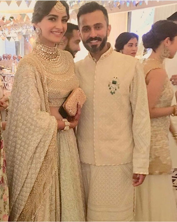Oo La La!  Sonam Kapoor and Anand Ahuja twin in white, looking spectacular for their mehendi and sangeet ceremony
