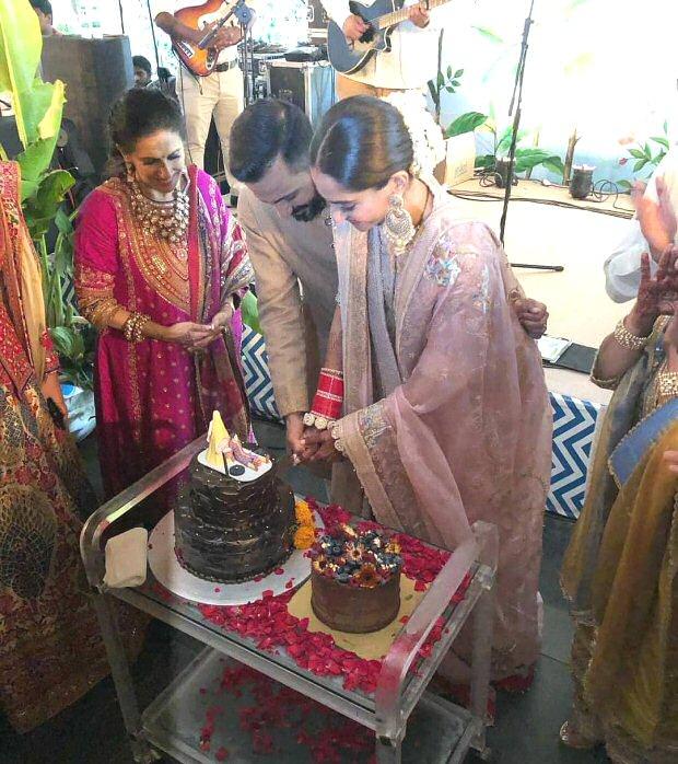 INSIDE Sonam Kapoor - Anand Ahuja's wedding: The newly wedded couple cut personalised cake, Ranveer Singh - Arjun Kapoor KISS Anil Kapoor