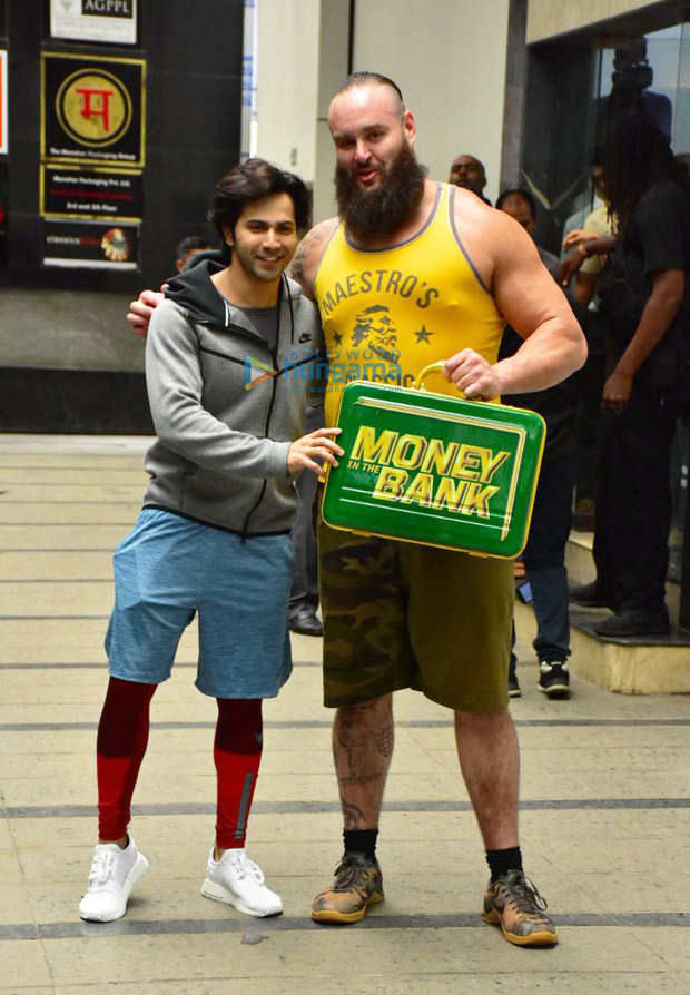 Varun Dhawan flexes his muscles with WWE Superstar Braun Strowman
