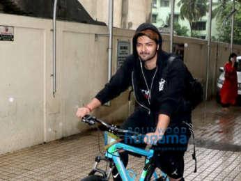 Ali Fazal snapped riding his bicycle in Juhu