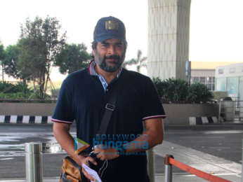 Kanika Kapoor and R Madhavan snapped at the airport