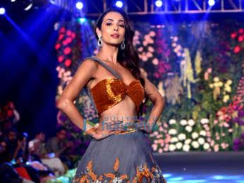 Malaika Arora walks the ramp at the Wedding Junction fashion show