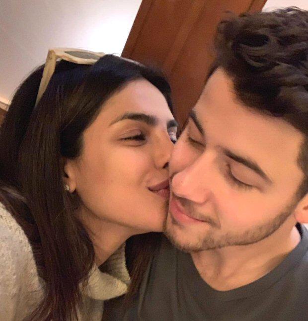 Priyanka Chopra gives a sweet kiss to hubby Nick Jonas as he surpasses The Rock to win GQ's Most Stylish Man of 2018
