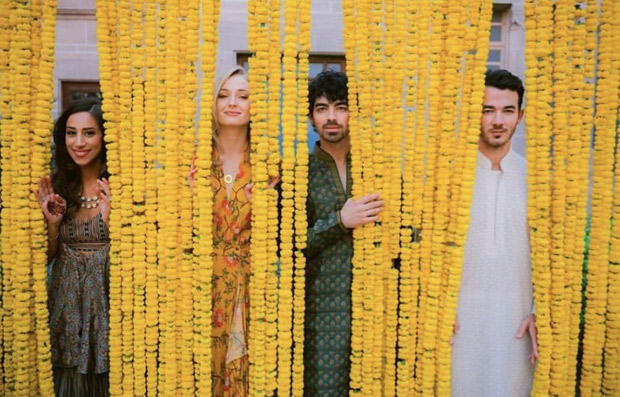 Priyanka Chopra and Nick Jonas Wedding - Game of Thrones star Sophie Turner and her fiance Joe Jonas pose with family in this picture!