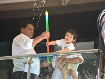 Taimur Ali Khan spotted playing Holi in his balcony