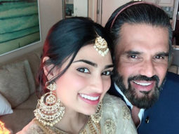 Athiya Shetty and Suneil Shetty are all smiles as they pose for a selfie at a wedding
