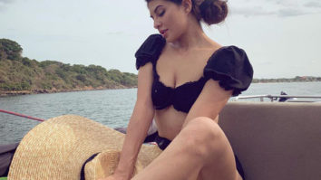 HOT! Jacqueline Fernandez will drive your Monday blues away as she poses in a black bikini on a yacht!