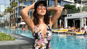 HOT MOMMY ALERT Sunny Leone looks absolutely breath-taking in a floral printed MONOKINI!