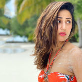 Hina Khan flaunts her perfect body in an orange BIKINI by the beach in Maldives