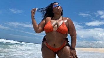 Lizzo enjoys beach vacation in red bikini during her trip to Brazil