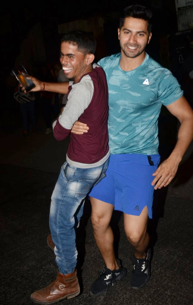 Varun Dhawan surprises a paparazzi as he lifts him his arms in this viral video