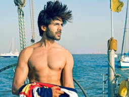 Kartik Aaryan strikes a pose shirtless on a boat, says 'You can lockdown a man, not his hair'