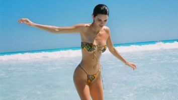 Kendall Jenner sizzles in tiny bikini flaunting her enviable beach body as she yearns for another vacation