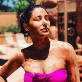 Nargis Fakhri soaks in the sun in pink bikini while enjoying mud bath