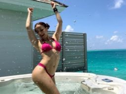 Elli AvRam poses in a pink bikini in a jacuzzi; says she is reliving her birth