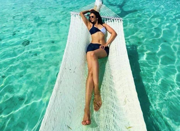 Bikini clad Rakul Preet Singh raises temperatures like a boss lady on a hammock
