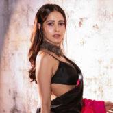 Nushrratt Bharuccha is giving us the festive vibe in her pink and black Shibori saree