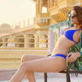 Ruhi Singh stuns in her latest photoshoot as she strikes a pose in a blue bikini in front of a palace
