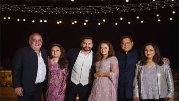 Newlyweds Varun Dhawan and Natasha Dalal strike a pose with their parents at the after-party