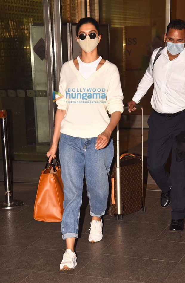 Deepika Padukone works a sweater with halter top, carries luxury Fendi bag worth over Rs. 2 lakhs