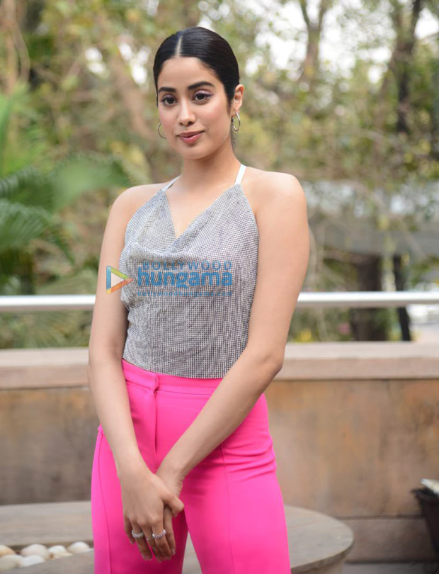 Janhvi Kapoor follows dopamine fashion trend in backless shimmery tip and pink pants for Roohi promotions