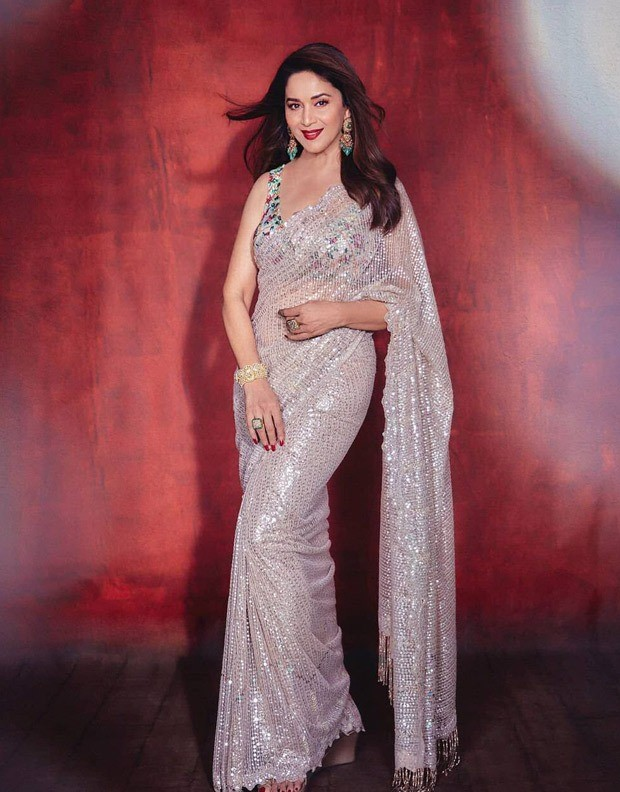 Madhuri Dixit's scintillating ivory sequin saree is perfect for the wedding season