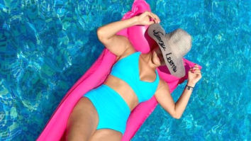 Sunny Leone flaunts her bikini body in an aqua blue swimsuit as she chills in the pool
