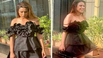 Nia Sharma sizzles in off-shoulder mini ruffle dress and pairs it with black pumps and handbag (1)
