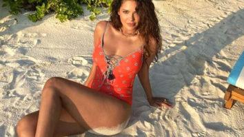 Esha Gupta sizzles in a orange monokini in latest post