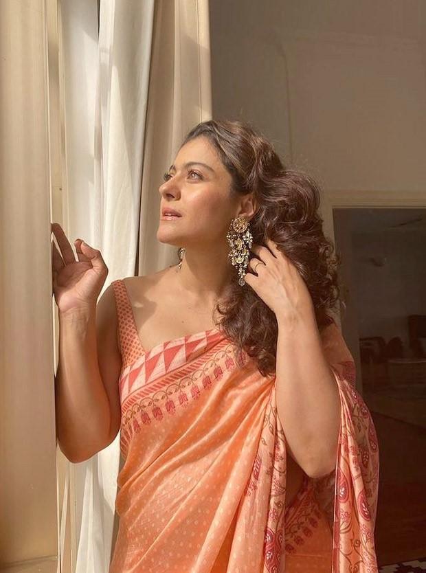 Kajol looks like a beautiful ray of sunshine in a printed orange saree