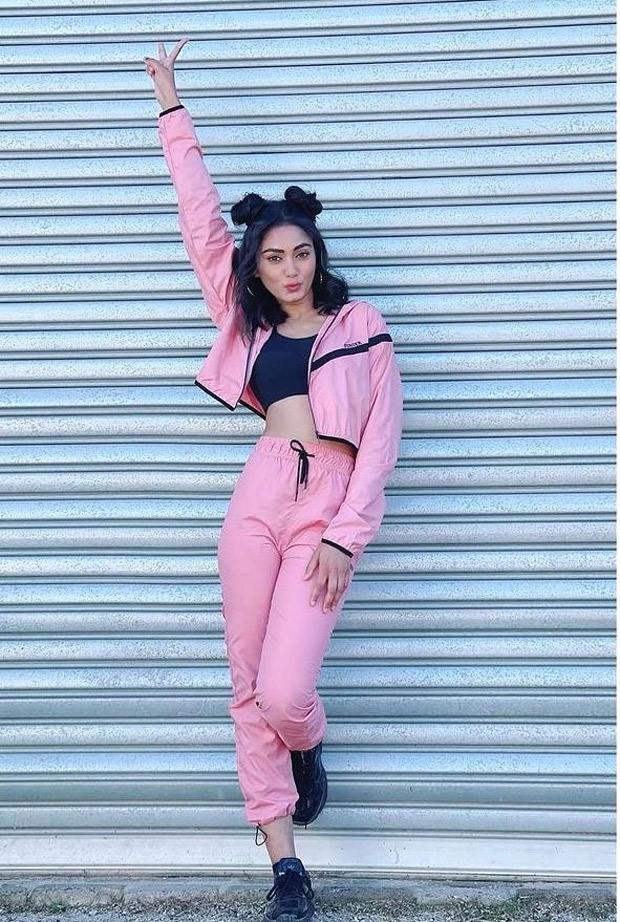 Khatron Ke Khiladi 11 Sana Makbul keeps it casual in pink athleisure and cat bun hairdo