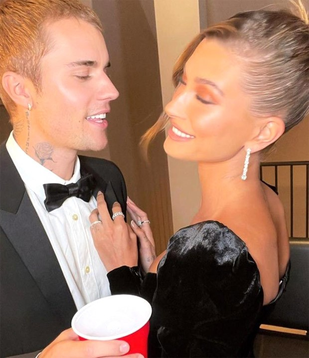 Justin Bieber looks dapper in black YSL tuxedo worth Rs. 2.14 lakh; wife Hailey Bieber stuns in lace Alessandra Rich thigh-high slit velvet dress