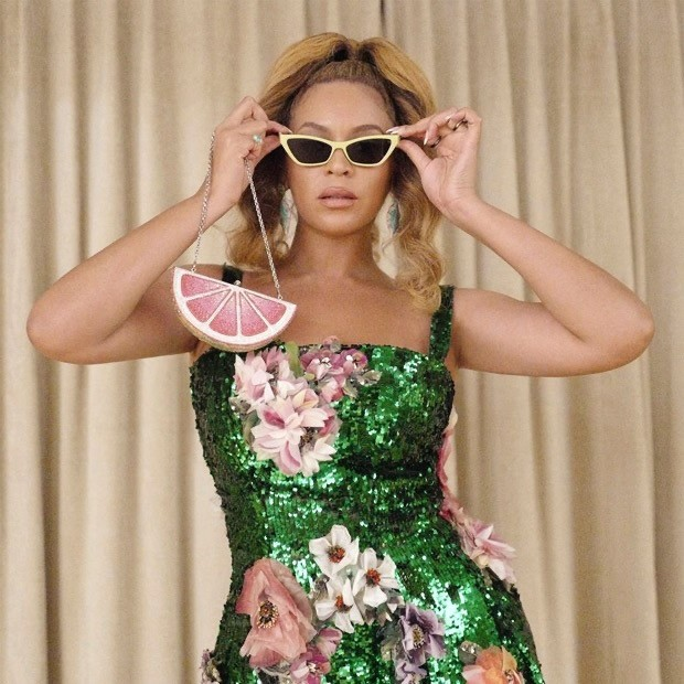 Beyoncé slays in a custom-made green sequin dress; carries a funky pink lemon slice clutch worth Rs. 3 lakh