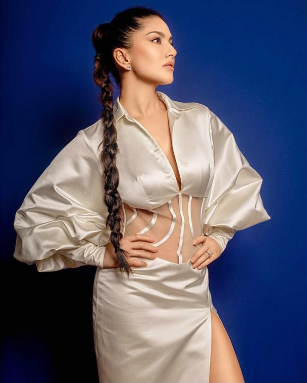 Sunny Leone flaunts her amazingly toned figure in a sexy off-white satin semi-sheer dress